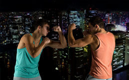 Young men fighting hand-to-hand Stock Photos