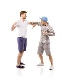 Young men fighting Stock Photos