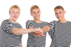 Young men in friendship joined his hands Stock Images