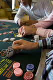 Young men gambling at poker table in casino, section Stock Photography