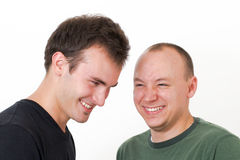 Young men goofing around laughing together Stock Images