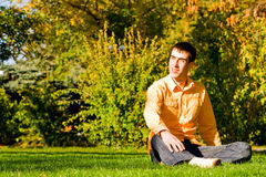 Young men on the grass Stock Image