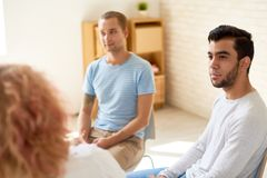 Young Men in Group Therapy Session royalty free stock photography