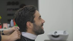 Young man in hair salon. Barber woman and her client Stock Images