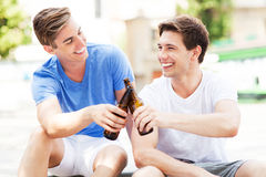 Young men having beer together Royalty Free Stock Image
