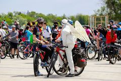 Young men in helmets and an angel costume with wings cycling, bicycle festival in the City Dnipro. Bike Day Dnepropetrovsk. Dnepr city, Ukraine, May 26, 2018 royalty free stock photo