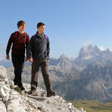 Young men hiking in the mountains Royalty Free Stock Photo