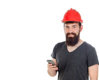 Young men with hipster look and red helmet looking the mobile Royalty Free Stock Photography