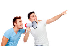 Young men and his friend screams through a megaphone Stock Images