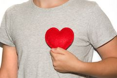 Young men hold red heart in hand. Love Royalty Free Stock Photo