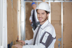 Young man insulating house Royalty Free Stock Photo