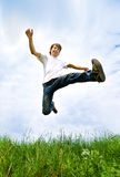 Young men jump. In the meadow Stock Photography