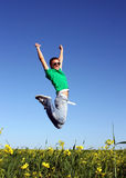 Young men jump in the meadow Stock Photography