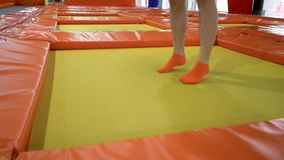 Young Men Jumping At Trampoline In Indoors Playground. Active People Male Having Fun At Sport Center. Slow Motion stock footage
