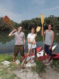 Young men with kayaks Royalty Free Stock Photo
