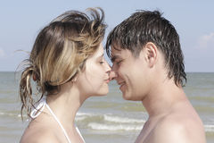Young men kissing in the background of the sea royalty free stock image