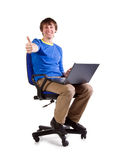 Young men with laptop on the chair Stock Photo