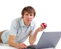 Young men with laptop and red apple royalty free stock photo