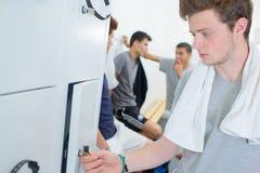Young men in locker room Stock Photos