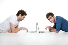Young men looking at laptops Royalty Free Stock Photos