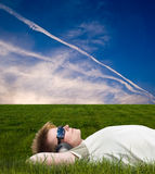 Young men lying on a meadow Stock Photos