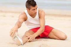 Young men making elongation exersice Stock Images