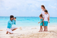 Family on a tropical beach vacation Royalty Free Stock Photo