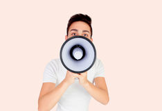 Young men with a megaphone Stock Photography