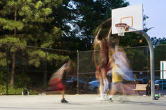 Young Men Motion Blur Playing Pickup Basketball Game At Park Stock Photo