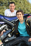 Young men with a motorbike Stock Photos