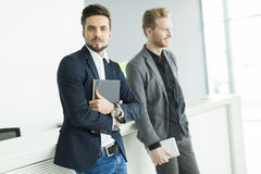 Young men in the office Stock Photo