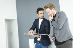 Young men in the office Stock Images