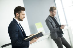 Young men in the office Stock Photography