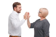 Young man and older woman giving a five to each other royalty free stock photography