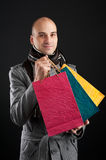 Young men with paper presents bags Royalty Free Stock Photography