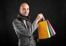 Young men with paper presents bags Stock Photos