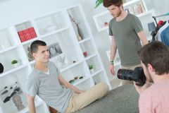 Young man photographing adolescent. Young men photographing adolescent photo Royalty Free Stock Photos