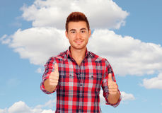 Young men with plaid shirt saying Okay Royalty Free Stock Image