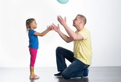 Young man playing with baby. Young men playing with baby in studio stock photo