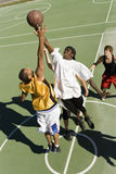 Young Men Playing Basketball On Court Stock Images