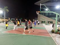 Young men are playing basketball, at night Stock Photography