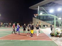 Young men are playing basketball, at night Stock Image