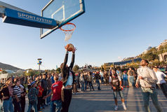 Young men playing basketball outdoor during popular city festival Tbilisoba Royalty Free Stock Photo