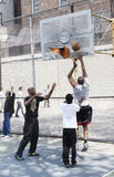 Young men playing basketball in the street of New York Royalty Free Stock Photos