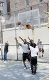 Young men playing basketball in the street Stock Photos
