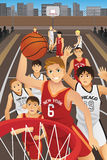 Young men playing basketball Stock Images