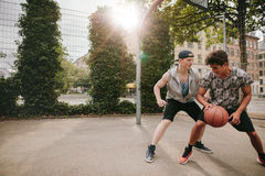 Young men playing a game of basketball Stock Photos