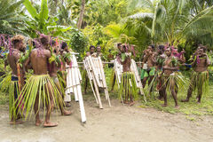 Young men playing panpipes, Solomon Islands Stock Image