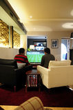 Young Men Playing FIFA - Video Games - Friends_Fun Stock Photography