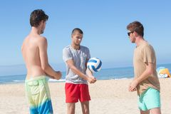 Young men playing volley ball on beach. Young men playing volley ball on the beach Stock Photos